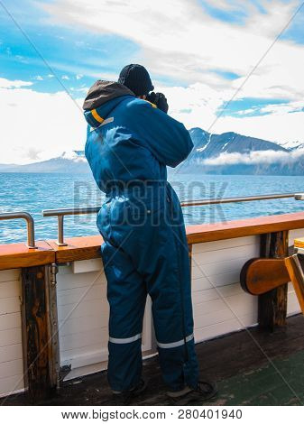 Photographer On An Eco-tourism And Eco-friendly Eco-friendly Whale Watching Tour In Iceland