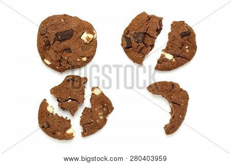 Whole And Broken Chocolate Cookies On White