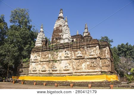Full view of the Maha chedi of Wat Chet Yot in Chiang Mai, Thailand. poster
