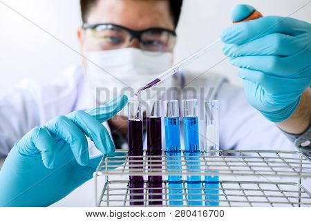 Biochemistry Laboratory Research, Chemist Is Analyzing Sample In Laboratory With Equipment And Scien