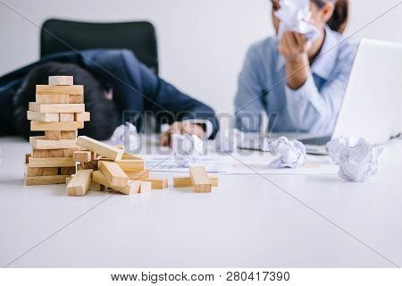 Boss And Executive Team Feeling Stress And Serious Of Fail Business, Partners Holding Heads In Hands
