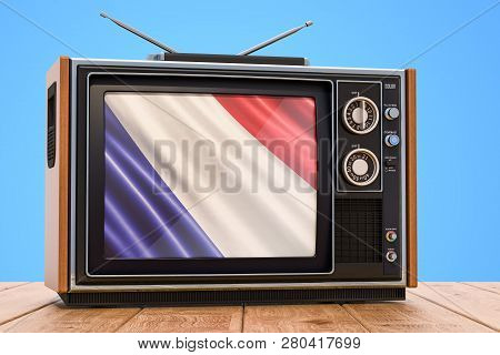 French Television Concept On The Wooden Table, 3d Rendering