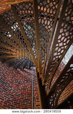 Metal Sprial Staircase From Below - Round Brick Building