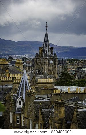 Rooftops In Edinburgh In Vertical Composition With Grey Sky