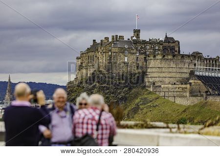 Tourists Taking Photos In Front Of Edinburgh Castle