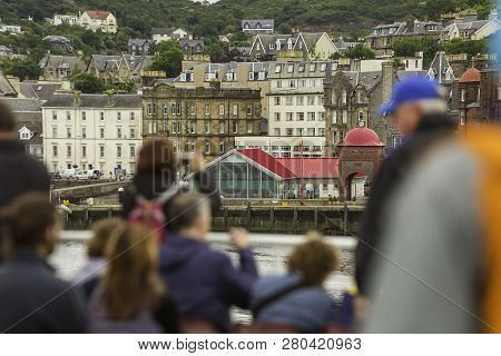 Tourists On A Passenger Ferry In Oban Harbor Looking Back Toward The City