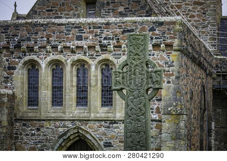 Saint Martins Cross In Front Of Historic Iona Abbey