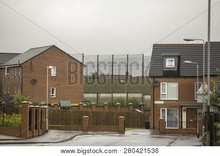 Homes Near Wall Permanently Dividing Protestant And Catholic Belfast Neighborhoods