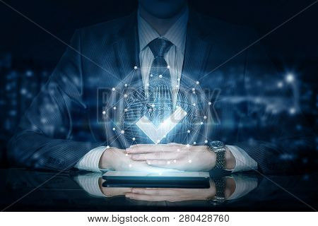A Businessman Is Sitting At The Table With The Digital Quality Sign System Hanging Above The Device