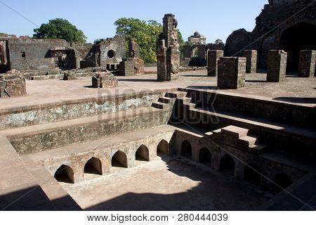 Dilapidated  Structures And Pond In Vicinity Of Hindola Mahal At Mandu In Madhya Pradesh, India, Asi