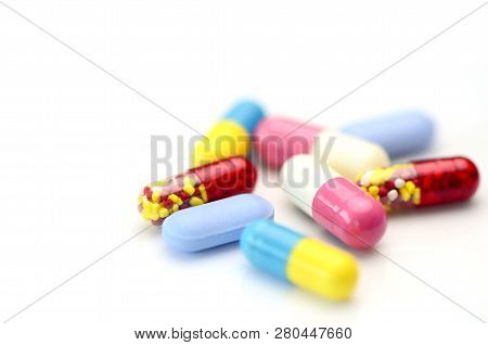 Oral Medication Background With Warm Light.colorful Of Oral Medications On White Background.