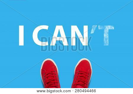 Legs In Red Sneakers On A Blue Background Correct The Text I Can Not In I Can. Concept For Self-beli