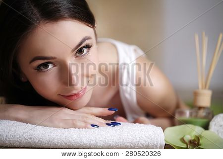 Body Care. Spa Woman. Beauty Treatment Concept. Beautiful Healthy Caucasian Girl Relaxing On Massage