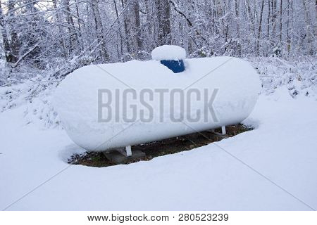Heating With Propane. Propane Tank For Home Heating During A Long Cold Winter.