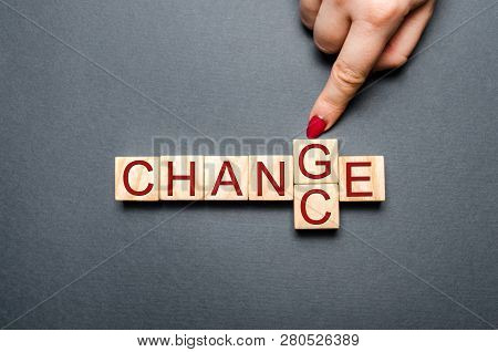 Wooden Cube With Word Change To Chance On Wood Table. Personal Development And Career Growth Or Chan