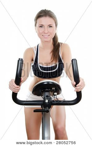 The girl is engaged on a velosimulator