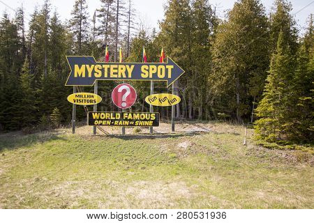 St. Ignace, Michigan, Usa - May 6, 2016: Billboard Sign For The Famous Mystery Spot In The Upper Pen