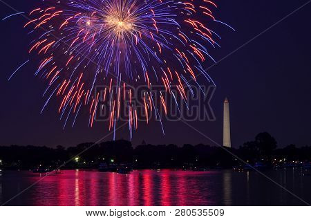 Fourth Of July Fireworks On The National Park Tidal Basin, With The Washington Monument In Washingto