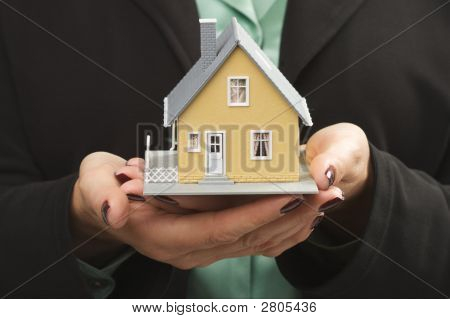 House In Female Hands