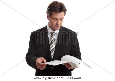 Businessman Reading Report Or Document