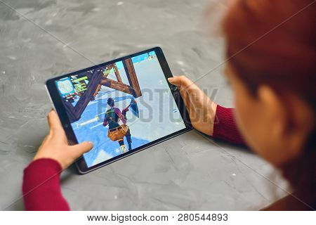 Bishkek, Kyrgyzstan - January 21, 2019: Woman Playing Fortnite Game Of Epic Games Company On Apple I