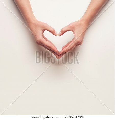 Man And Woman Hands Shows Heart Gesture On Light Grey Background. Congratulations On Valentines Day