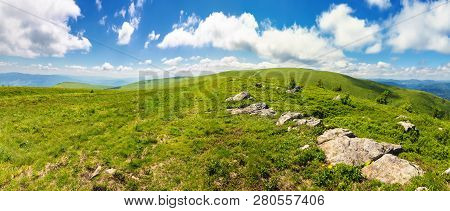 Panorama Of Beautiful Carpathian Alpine Meadows. Wonderful Summer Landscape. Fluffy Clouds On The Bl