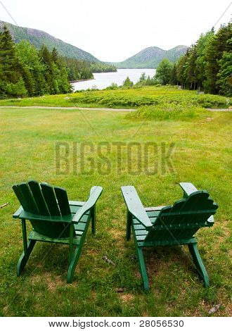 lounge chairs overlooking Jordon Pond and the Bubble Mountains