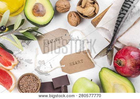 Selection Of Foods For Healthy And Strong Heart And Blood System On White Stone Background. Copy Spa