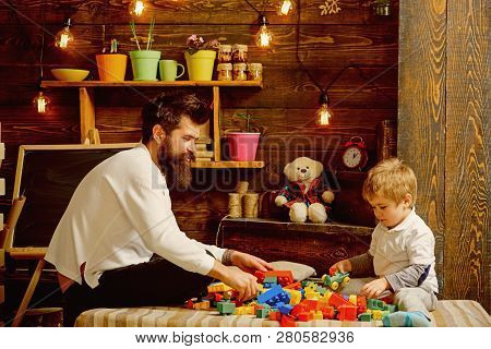 Construction Concept. Father And Child Play With Toy Construction Set. Father And Son Build Structur