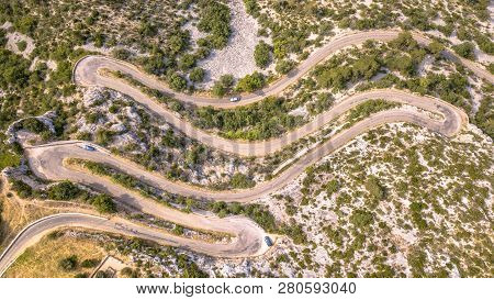 Aerial Top Down View Of Hairbpin Bend Road In Cevennes, Occitania, France