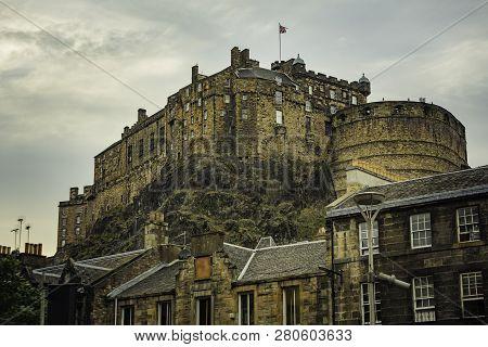 Edinburgh Castle On A Cloudy Day From Street Below