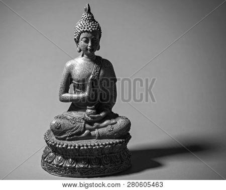 Zen Buddah Statue Casting A Shadow In Light