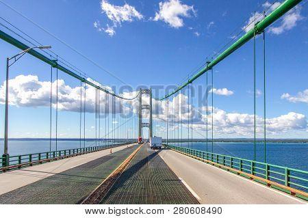 Driving Across Mackinaw Bridge. Four Lane Highway With Traffic On Interstate 75 Crossing The Mackina