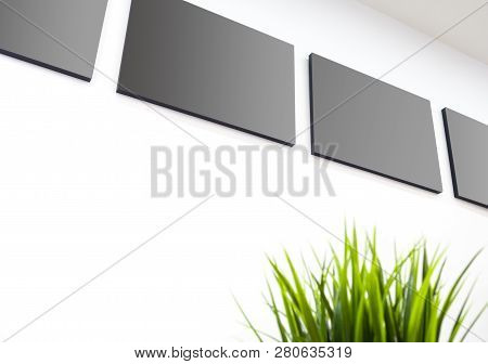 The Blank Gray Canvas Picture Frame On The Wall