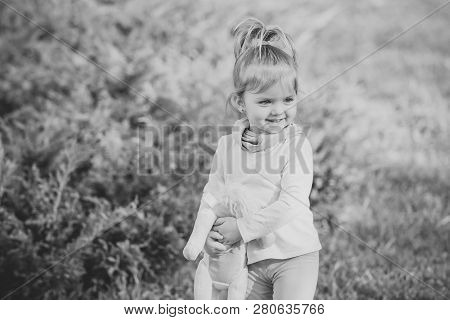 Happy Girl With Soft Toy Smile On Natural Background. Child, Childhood, Playtime, Lifestyle Concept