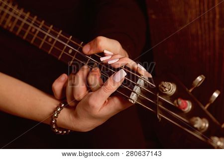Instrumental Music Live. Couple In Love Play Duets. Male And Female Hands Play The Electric Guitar.