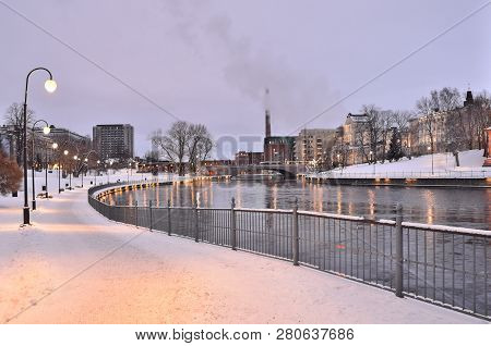 Tampere, Finland. River Tammerkoski Embankments At Winter Twilight