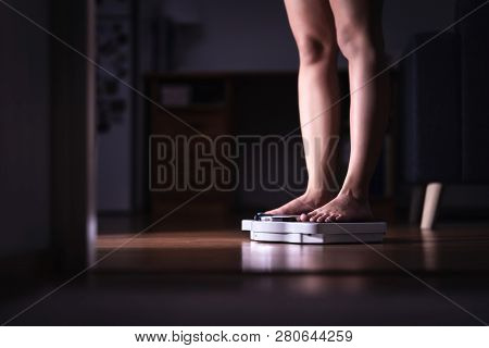 Weight Loss And Diet Concept. Lady Standing On Scale. Woman Weighing Herself. Fitness Lady Dieting.