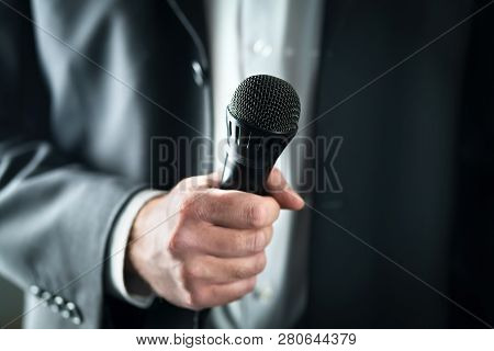 Business Man Holding Microphone. Public Speaking And Giving Speech In Suit For Audience Concept. Fia