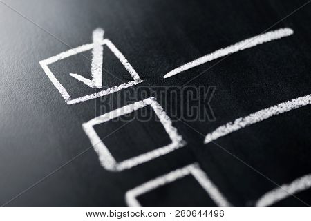 Check List On Blackboard Macro Close Up. Document Of Finished Work Duties And Responsibilities. Agen