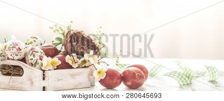 Easter Background With A Basket And Red Eggs With Flowers, The Bright Interior, The Concept Of The E