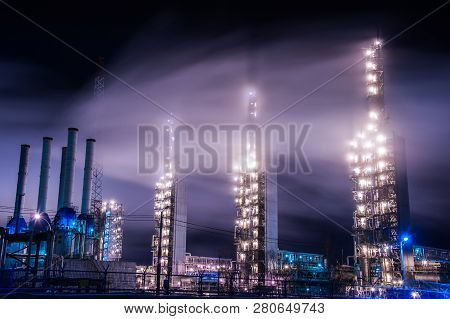 Chemical Industry Distillation Towers Detail At Night. Petrochemical Background. Long Exposure At Wi