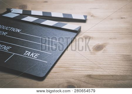 Take Action. Movie Clapper Board On Wooden Background.