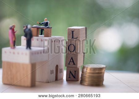 Miniature Businessmen Talk On Money Loan Contract Agreement, Discuss About A Company Credit And Loan