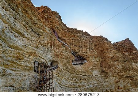 Yhe Old Iron Staircase In The Rock .