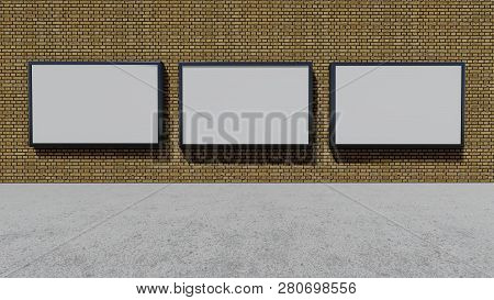 Three Blank Billboards On The Brick Wall