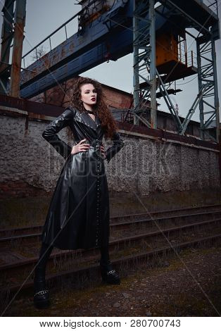 Fashion Shot: Portrait Of A Pretty Rock Girl (informal Model) In Leather Coat Standing At Railroad (