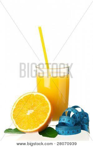 Glass of fresh orange juice with measure tape and orange fruits on white background