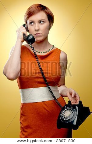 Woman using retro telephone